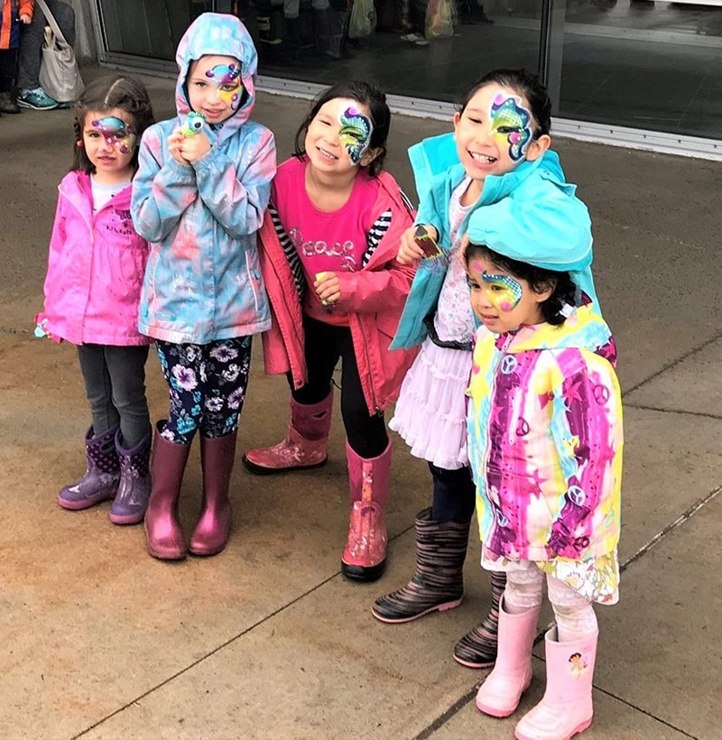 Group of children with painted faces