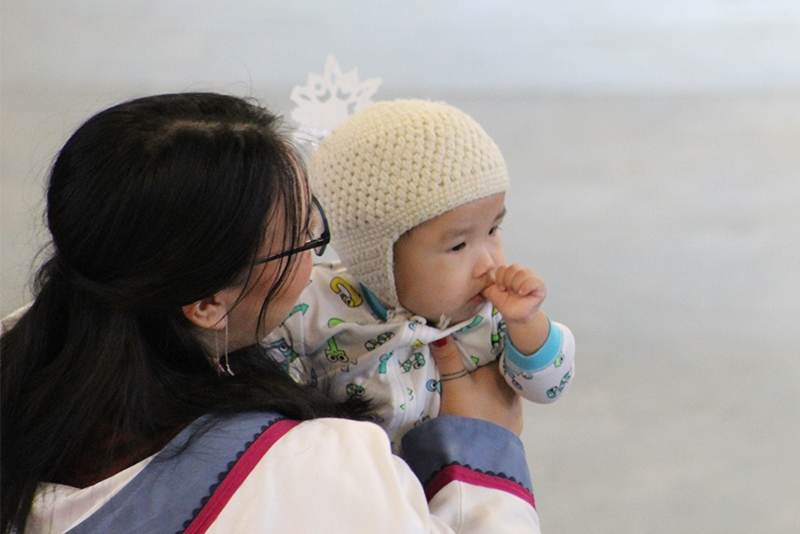 Inuit woman holding a baby