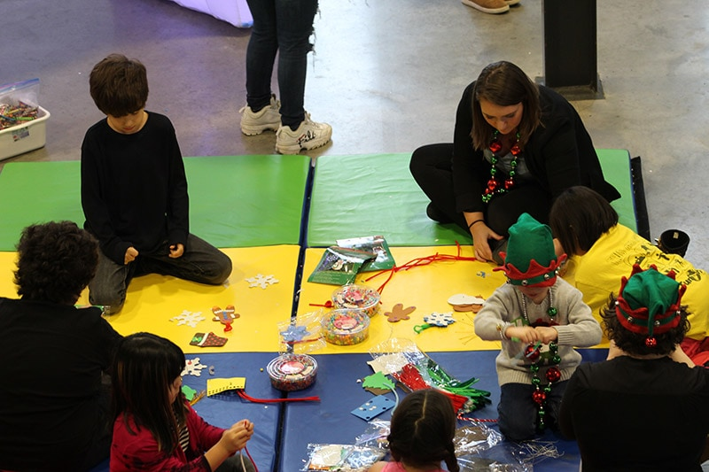 Group of adults and children making crafts