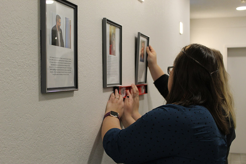 Two women putting up pictures at Mamisarvik Healing Centre